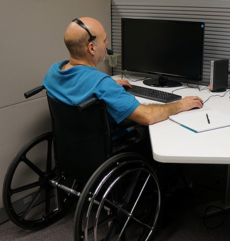 Wheelchair user at desk